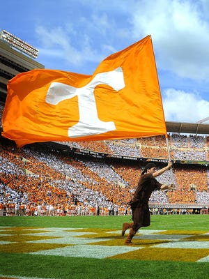 The checkerboard pattern shows up as the Vol and Smokey make a lap after a Tennessee field goal.