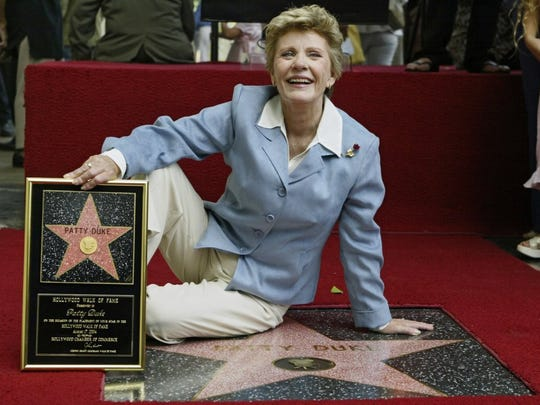 """In this Aug. 17, 2004 file photo, actress Patty Duke is honored with a star on the Hollywood Walk of Fame in Los Angeles. She is one of numerous celebrities whose deaths have been linked to sepsis (often reported as """"complications of"""" another illness), according to the Sepsis Alliance."""