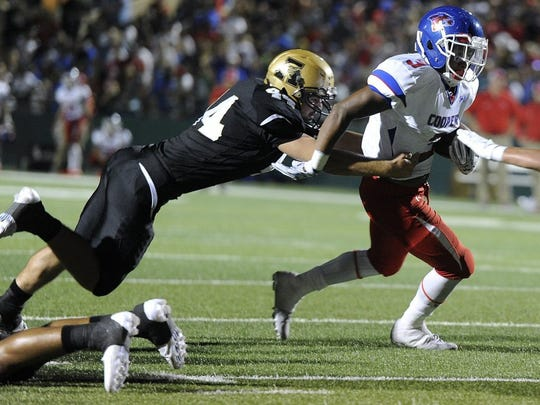 Thomas Metthe/Reporter-News Cooper running back Tyrees Whitfield (3) slips away from Abilene High linebacker Dackota Triano (42) during the first quarter of the Cougars' 55-38 loss to Abilene High in the crosstown football game on Friday, Sept. 9, 2016, at Shotwell Stadium.
