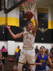 Galena's Moses Wood(11) snags a rebound while taking