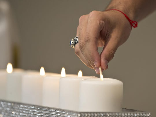 Center for Jewish Life in Marlboro hosts a Holocaust Remembrance Evening to share stories of suffering and liberation. Candles are lit in memory of the six million Jews murdered in the Holocaust.