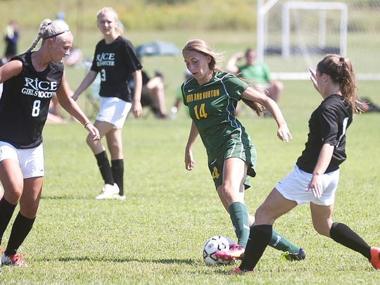 Burr and Burton midfielder Brooke Woodard (14) dribbles through the Rice defense during a preseason scrimmage at Essex last month.
