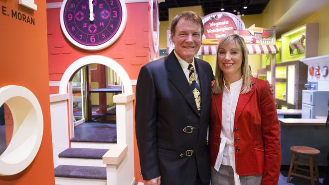 Danny Wegman and his daughter, Colleen Wegman, attend the opening of the Wegmans Wonderplace exhibit at the Smithsonian National Museum of American History in 2015.