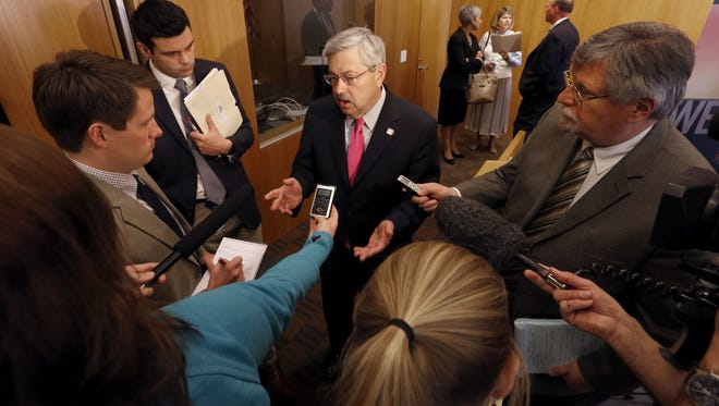 Gov. Terry Branstad speaks with the media following a news conference in April.