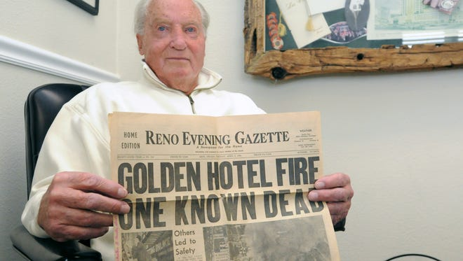 Bill Tomerlin, former owner of the Golden Hotel, holds a copy of the Reno Evening Gazette on the day of the fire April 3, 1962.