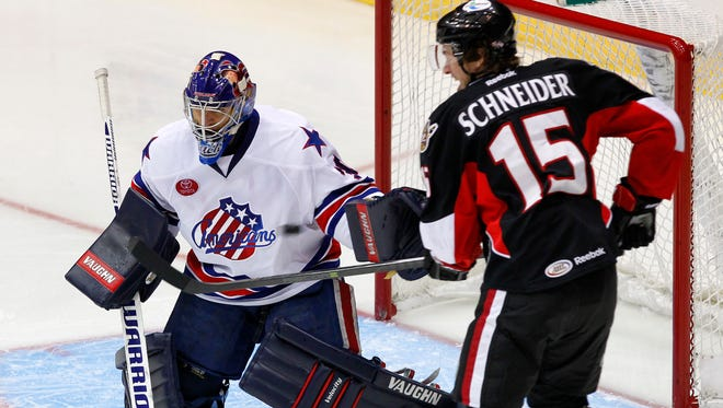 Matt Hackett allowed 7 goals on Sunday. This is a file photo from a Jan. 8 game against the Binghamton Senators and Cole Schneider.