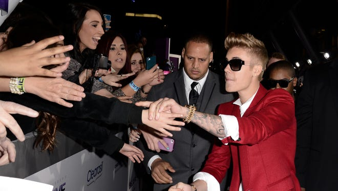 """Singer Justin Bieber arrives at the premiere of the feature film """"Justin Bieber's Believe"""" at Regal Cinemas L.A. Live on Wednesday."""