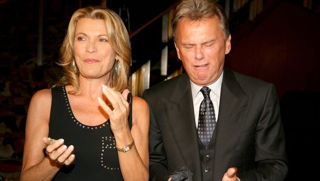 Host of the TV game show 'Wheel Of Fortune' Pat Sajak and model Vanna White feed each other cake at the the 25th anniversary celebration of 'Wheel Of Fortune' at Radio City Music Hall  September 27, 2007 in New York.