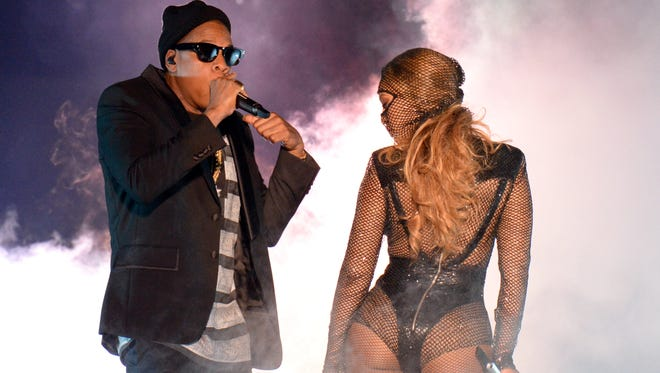 Jay Z and Beyonce perform during the opening night of their On the Run tour at Sun Life Stadium on June 25, 2014, in Miami.