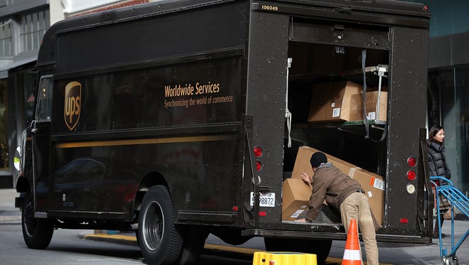 UPS delivery workers deliver packages.