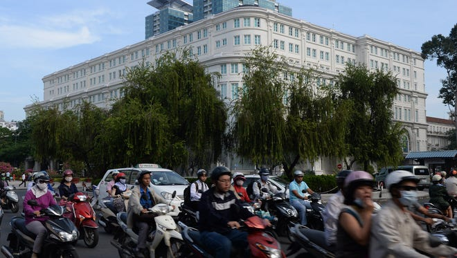 Traffic rolls past the newly built luxury shopping center Union Square in Ho Chi Minh City, Vietnam, on Nov. 20, 2013.