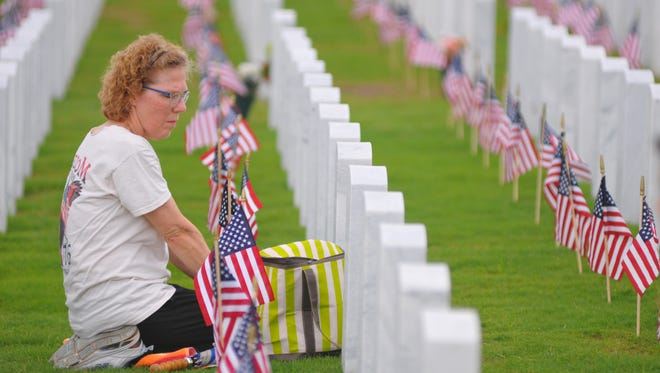 A large crowd attended the Memorial Day Observance at the Canaveral National Cemetery in Mims  on Monday. Sandra Speroni from Casselberry, Florida sat at her fiance's grave and sang Elvis songs to him. He was a Vietnam vet who died three months before they were supposed to get married.