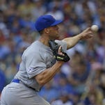 Chicago Cubs starting pitcher Clayton Richard throws against the Milwaukee Brewers during the first inning of a baseball game, Sunday, Aug. 2, 2015, in Milwaukee. (AP Photo/Jeffrey Phelps)