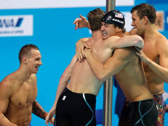 United States' Caeleb Dressel, Kevin Cordes, Nathan