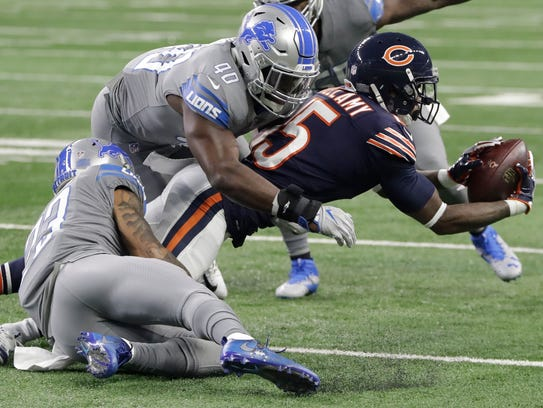 Bears receiver Josh Bellamy is tackled by Lions linebacker