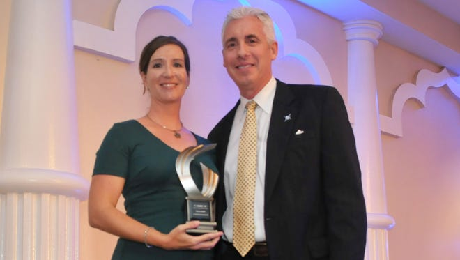 Kathryn Rudloff, 4 Under 40 finalist, is executive director of Business Voice Political Committee. She is pictured earlier this year with Josh Field, chairman of LEAD Brevard, at a LEAD Brevard awards event.