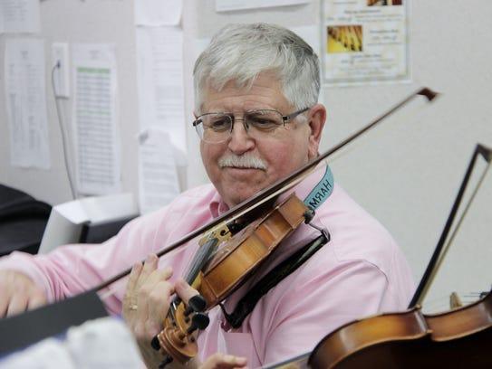 Harmony Magnet Academy music teacher Michael Allard