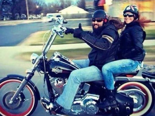 Brian Raymond and Jessica Kelly ride a Harley. The