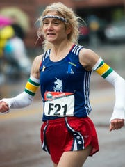 Mary-Lynn Currier runs during the 2013 Vermont City