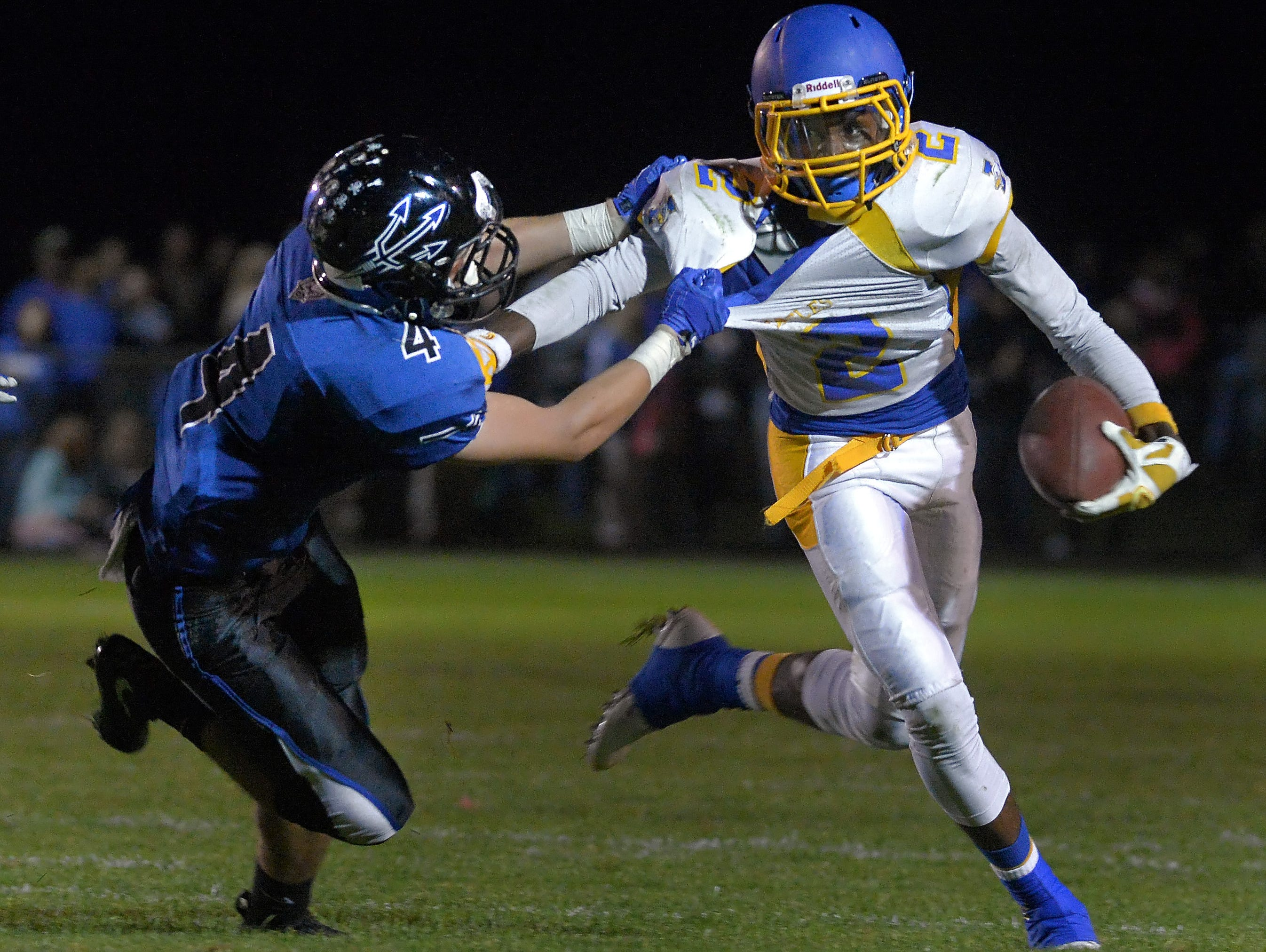 Irondequoit's Ty'Sean Sizer, right, tries to break the tackle of Brockport's Shane Hogan during a game at Brockport High School on Friday, September 25, 2015.