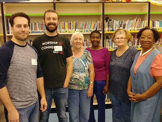 1 PSL Church members delivered boxes of books to Northport.