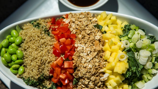 Celebrated Cuisine, Inc. owner Laura Briscoe makes Tropical Kale Chopped Salad with Quinoa, Mango, Edamame and LocoCocoNut Crunch, Citrus Reduction on Tuesday, August 5, 2014.
