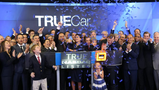 TrueCar founder and CEO Scott Painter, wife Ipo and children Luke, Noah, Zoe, and Indy celebrate NASDAQ opening bell on TrueCar's first day of trading.