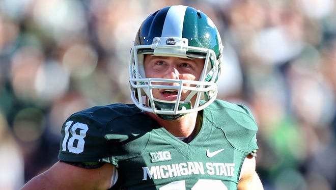Michigan State Spartans quarterback Connor Cook (18) looks on during the first quarter of a game at Spartan Stadium.