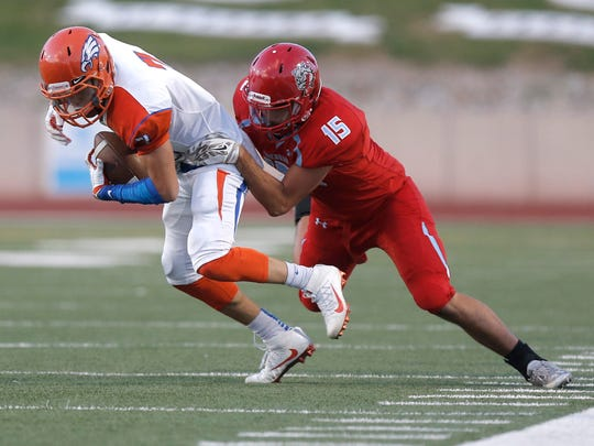 Canutillo's Cristian Martinez is taken down by Socorro's Angel Nevarez Thursday night at the SAC.