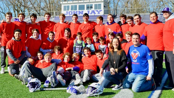 Members of the John Jay boys lacrosse team pose with