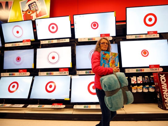 In this Nov. 28, 2014, file photo, a customer walks