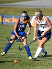 Elco High School Raider Cherish Weaver battles a Viking