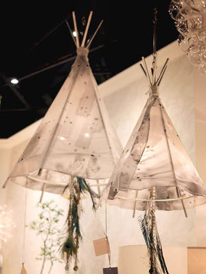 Currey & Company's Teepee chandeliers by fabric designer Aviva Stanoff.