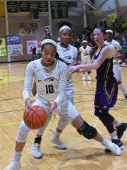 Captain Shreve's Nahja Scott controls the ball against