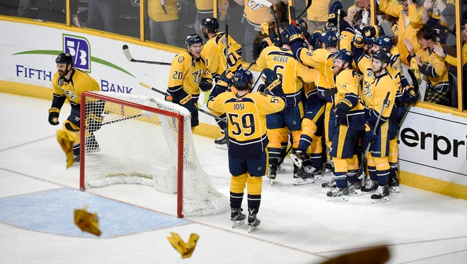 Predators celebrate the overtime win tying up the series against the Sharks at Bridgestone Arena Monday May 9, 2016, in Nashville, Tenn.