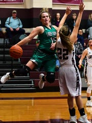 May's Skylar Jenkins jumps after a ball on the baseline while Eula's Megan Scott (22) defends in MHS' 44-40 win at Eula on Jan. 17. 2018.