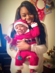Chelsea Mayes with her 3-month-old son, Kyson, in December