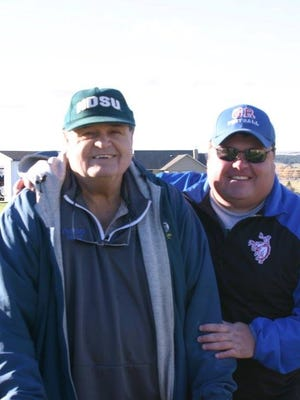 Former Plentywood football coach Ron Smith (left) and his son, Grass Range-Winnett coach TJ Smith, are shown in this undated photo at the Rangers' football field. Ron Smith died Thursday at the age of 74.
