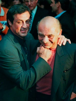 """From Nov. 15, 1996, Sylvester Stallone, left, mugs with """"Rocky"""" co-star Burt Young before a screening of the 1976 film to celebrate its 20th anniversary, at the Academy of Motion Picture Arts & Sciences in Beverly Hills, Calif. """"Rocky"""" finished tied for No. 2 in The Associated Press Top 25 favorite sports movies poll."""