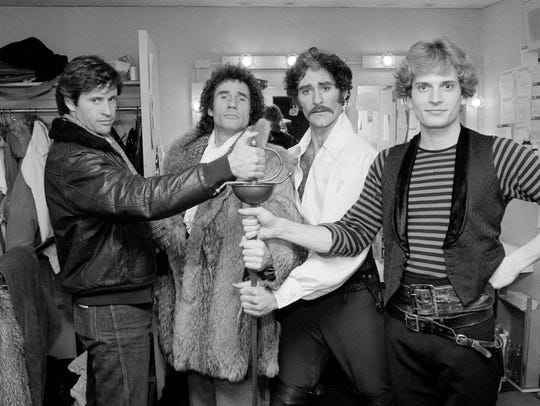 """Actors Robert Hays, left, and Jim Dale, second from left, have a try at the sword with Kevin Kline and Rex Smith, right, stars of the Broadway play """"The Pirates of Penzance,"""" after a performance in New York, Jan. 20, 1981. Dale, narrator of all seven """"Harry Potter"""" audio books will perform his one-man show, """"Just Jim Dale,"""" at the 99-seat theater on Dec. 13 and 15."""