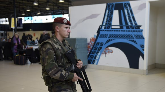 A French soldier patrols at Paris' Charles de Gaulle