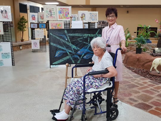 "Moving Colors, series four ""Chamorro Seascapes"" contains artwork from Yeon Sook Park and residents of St. Dominic's Senior Care Home in Barrigada. Pictured: Carmelita Chargualaf of St. Dominic's Senior Care Home and Park."