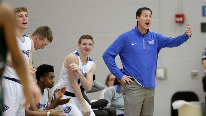 Hamilton Southeastern Royals head coach Brian Satterfield in the first half of their game Thursday, February 23, 2017, evening at Hamilton Southeastern High School in Fishers..