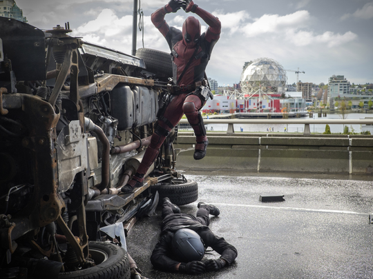 Deadpool (Ryan Reynolds) pounces on an adversary.