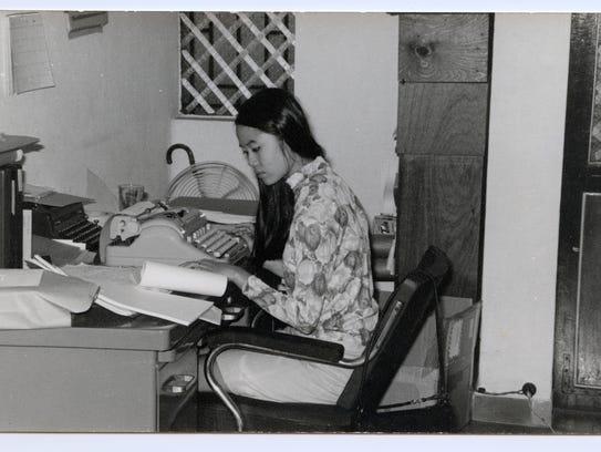 Mai Elliot working in Rand office.