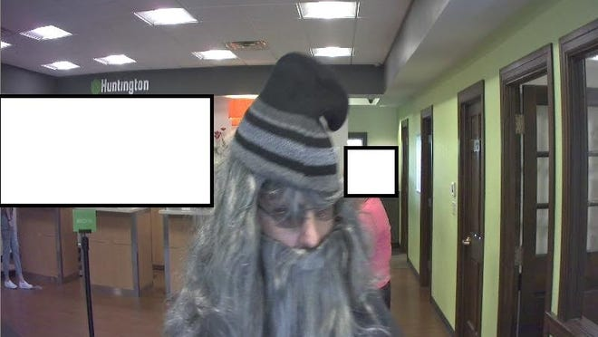 Suspect in robbery at Huntington National Bank in Cambridge.