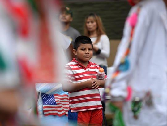 Erik Hernandez, 8, of Bridgeton watches traditional