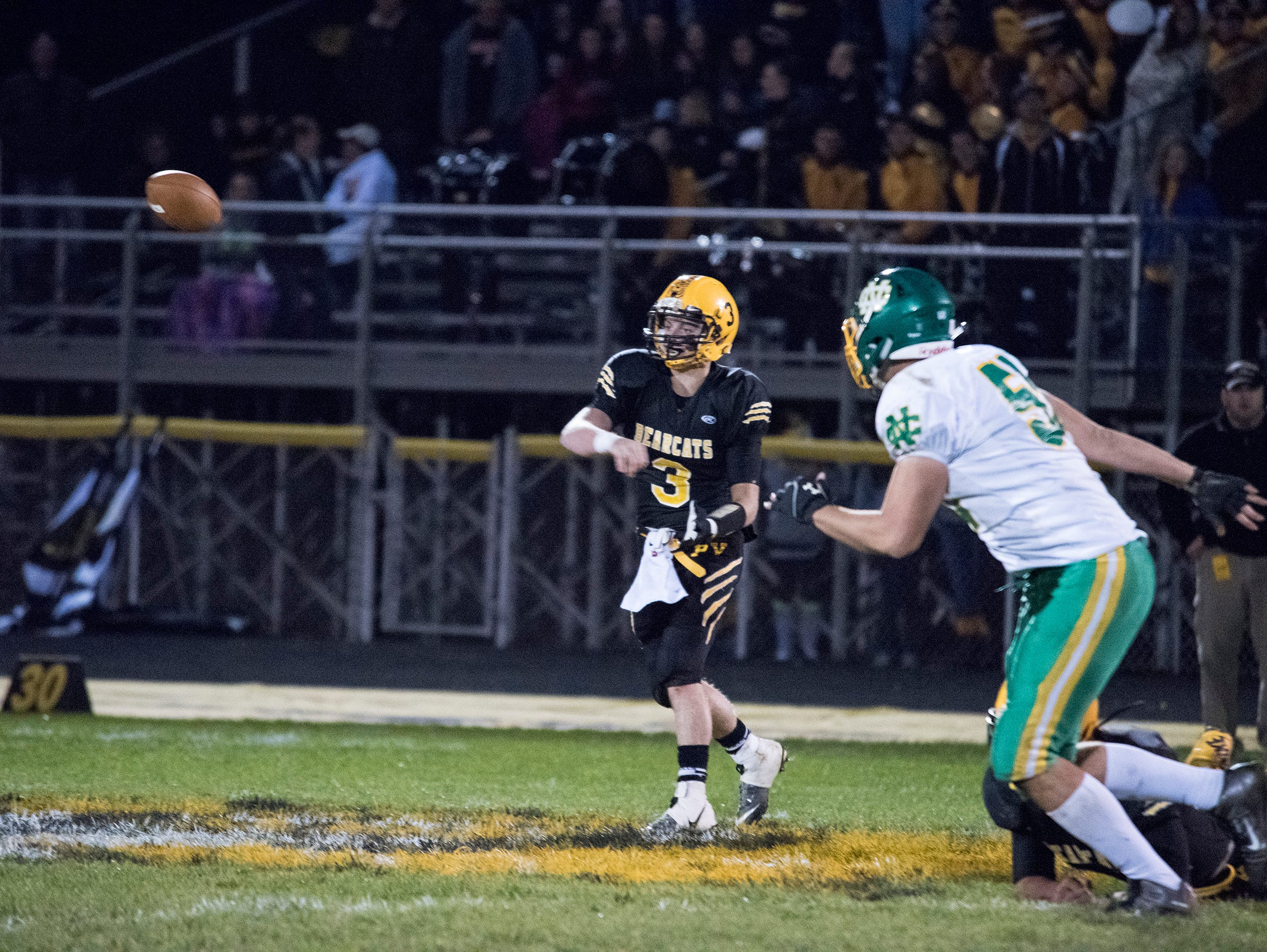Paint Valley quarterback Anthony McFadden throws a pass during the first quarter Saturday night.
