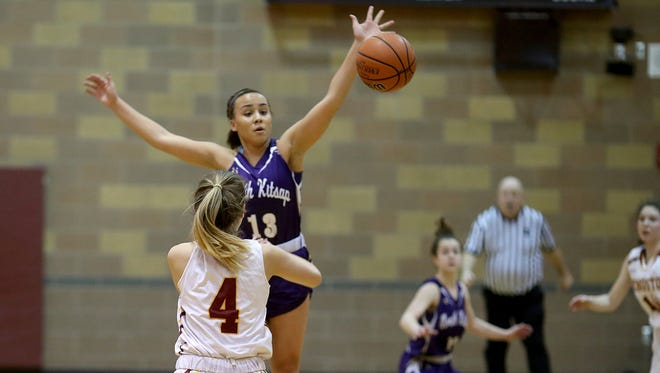 North Kitsap's Olivia Selembo, top, and the Vikings are looking to reach the state tournament for the first time since 1988. North Kitsap plays East Valley of Yakima in a regional game Friday.