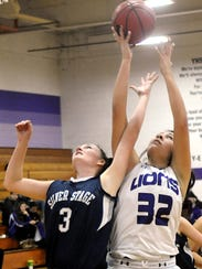Yerington's Alexceah Emm comes up with a rebound against
